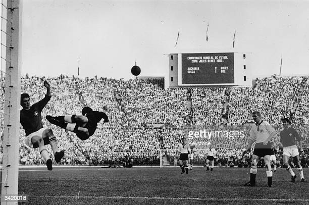 A leaping German goalkeeper foils the Swiss attack during a first round World Cup match in which Germany beat Switzerland 10