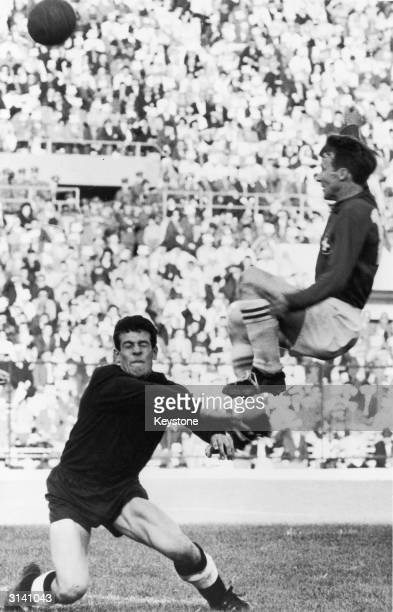 German goalkeeper Anton Alleman challenging the Swiss player Wolfgang Fahrian for the ball during a World Cup game