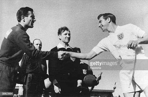 The team captains shake hands at the World Cup football match in Rancagua when England beat Argentina 31