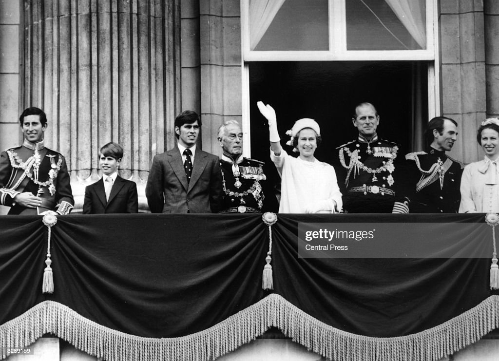 Queen Elizabeth II and Prince Philip, Duke of Edinburgh waving from the balcony of Buckingham Palace during celebrations for the Queen's Silver Jubilee, with other members of the British royal family. (Left to right); Charles, Prince of Wales, Prince Edward, Prince Andrew, (Louis, 1st Earl Mountbatten of Burma) (1900 - 1979) Captain Mark Phillips and Princess Anne.