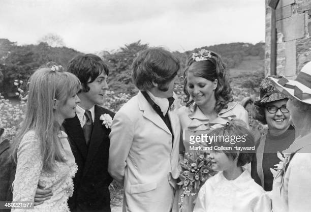 Best man Paul McCartney and his girlfriend Jane Asher pose together with Paul's brother Mike McGear and his wife Angela Fishwick at their wedding...