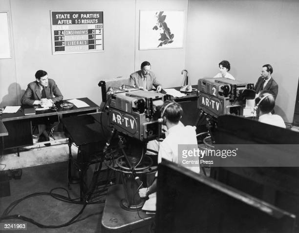 News reporters broadcasting the general election results from the ITN newsroom
