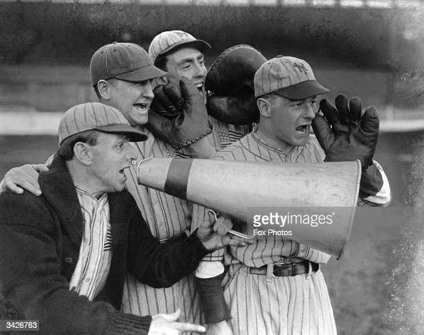 A megaphone helps the coach to catch the players' attention at the start of a baseball season in Stamford Bridge London