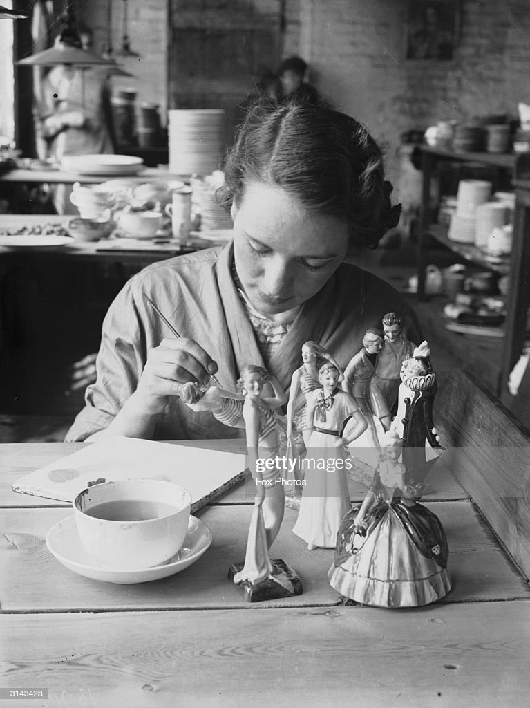 A woman artist hand painting china at Mintons of StokeonTrent