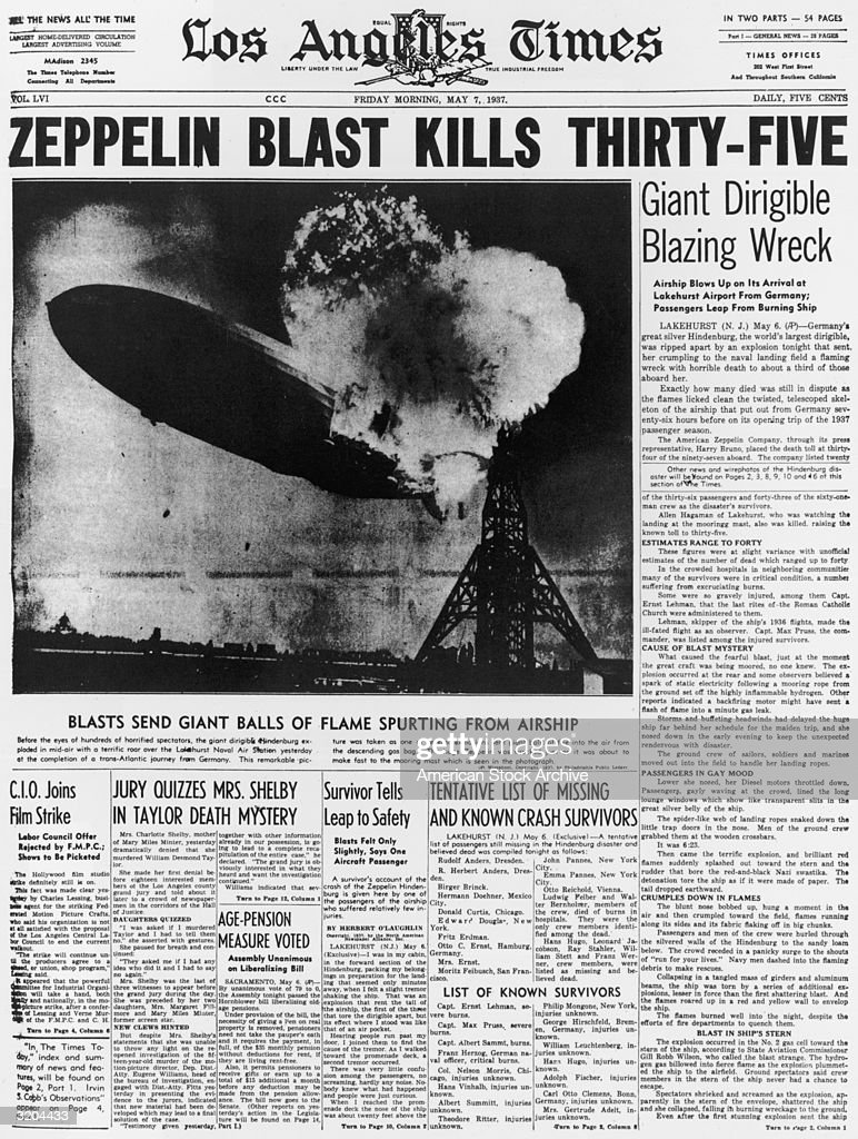 Front page of the 'Los Angeles Times,' announcing the previous day's explosion of the German-made dirigible, the 'Hindenburg'. A photograph shows the rear of the dirigible in flames. Thirty-six people were killed in the crash at the Lakehurst Naval Air Station in New Jersey. The headline reads 'Zeppelin Blast Kills Thirty-Five'.