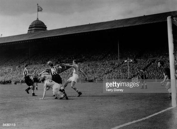Newcastle United and Manchester City footballers including Don Revie challenging for the ball during the FA Cup final