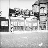 Graffiti on the gates outside Stamford Bridge the home of Chelsea football club