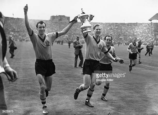 Wolverhampton Wanderers players Camp and Slater with the FA Cup after their team beat Blacburn Rovers 30