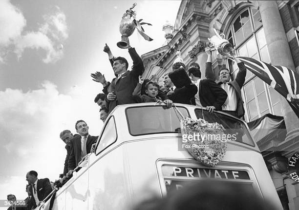 Tottenham Hotspur football club celebrate from the roof of an open top bus on their way to Tottenham Town Hall for a reception given by the Mayor...