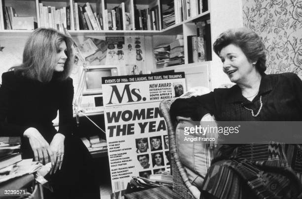 American feminist activists and writers Gloria Steinem and Patricia Carbine cofounders of Ms Magazine talking in an office The pair were seeking...