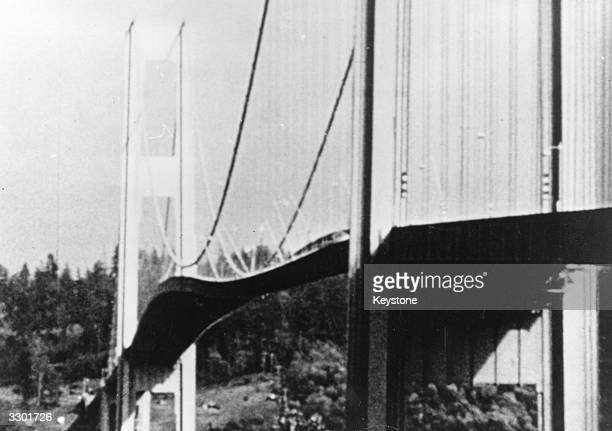 Tacoma Narrows suspension bridge in Puget Sound Washington vibrating violently just prior to its collapse due to hurricane winds causing a violent...