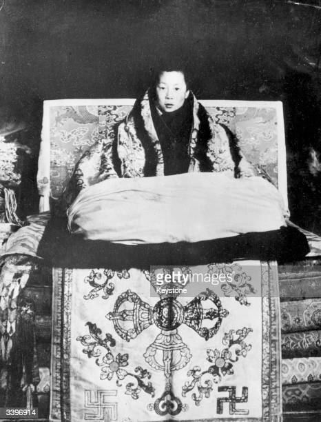 The boy Dalai Lama Tenzin Gyatso at Lhasa He and the Regent of Tibet were 'prevented' from leaving Lhasa the capital by opposition from the lamas of...
