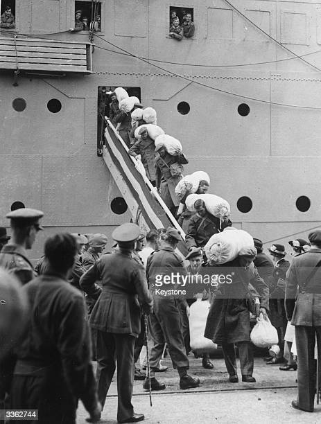 The first British servicemen to be liberated from Japanese prisoner of war camps disembarking from P O liner SS Corfu at Southampton carrying their...