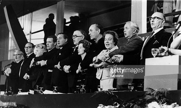 Labour Prime Minister Harold Wilson singing with members of his cabinet and the National Executive Committee at the Labour Party Conference Included...