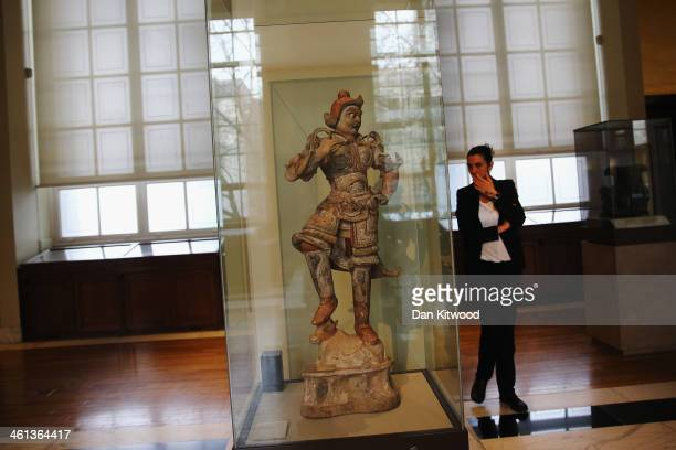 A 7th or 8th century 'Painted pottery or tomb Guardian' stands in a case during a press call at the British Museum on January 8 2014 in London...