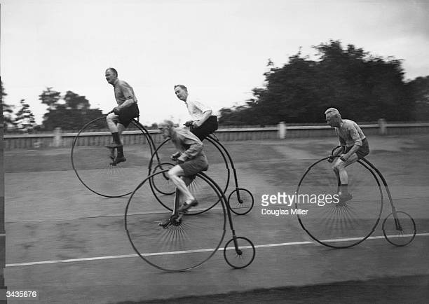 A group of elderly cycling enthusiasts on their Victorianstyle penny farthings training for the 'ordinary' race at Herne Hill track
