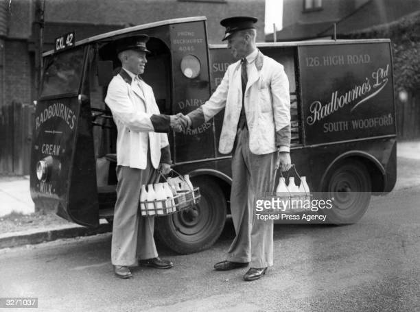 R G Budd a milkman is congratulated by a colleague in Essex after winning the Public Courses Golf Championship