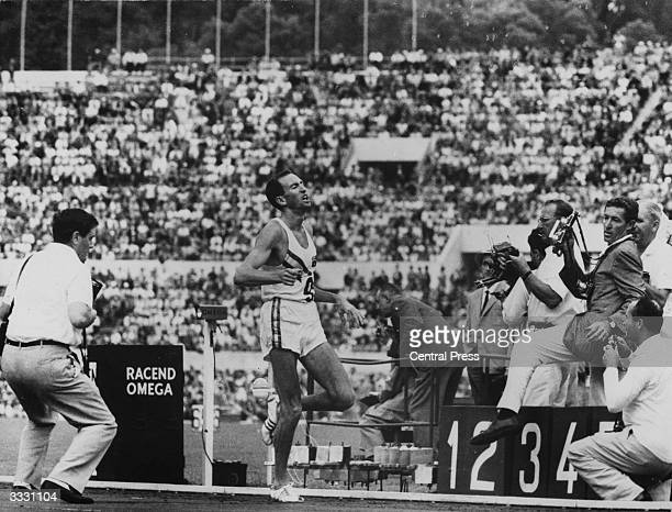 Photographers capture Australian athlete Herb Elliot winning the final of the 1500 metres and setting a new world record of 3 minutes 356 seconds at...