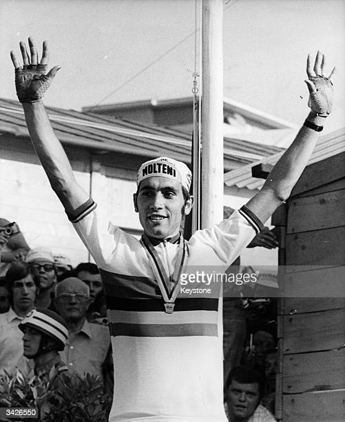 Belgian cyclist Eddy Merckx celebrating his victory in the world professional road championship over 168 miles at Mendrisio in Switzerland