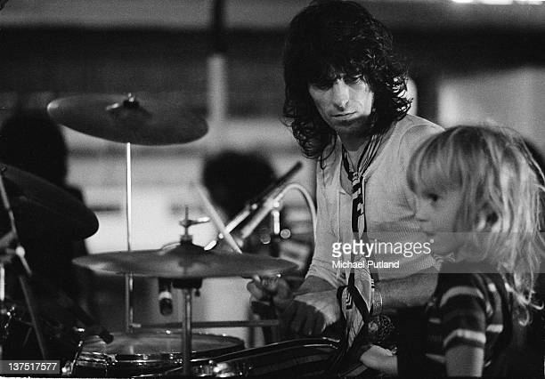 Guitarist Keith Richards of the Rolling Stones plays drums during a soundcheck with his son Marlon Richards beside him Wembley Empire Pool London 7th...