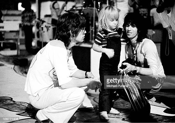 Singer Mick Jagger of the Rolling Stones backstage with guitarist Keith Richards and his son Marlon at Wembley Empire Pool in London England on 7th...