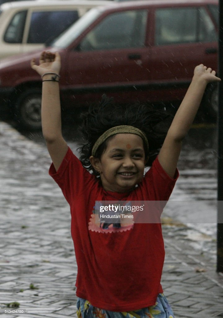 7-year -old Udita enjoys rain at marine drive on August 1, 2005 in Mumbai, India. in Mumbai, India. and government declared three days leave for all schools and collages due to heavy rains.