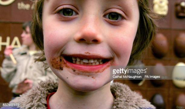 7yearold Kim McCauley reacts after tasting part of the worlds first edible chocolate billboard at Covent Garden central London
