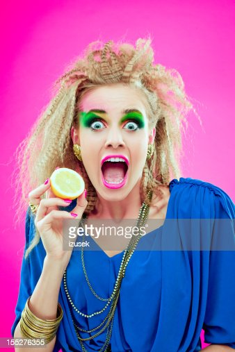 80s style girl with lemon stock photo getty images