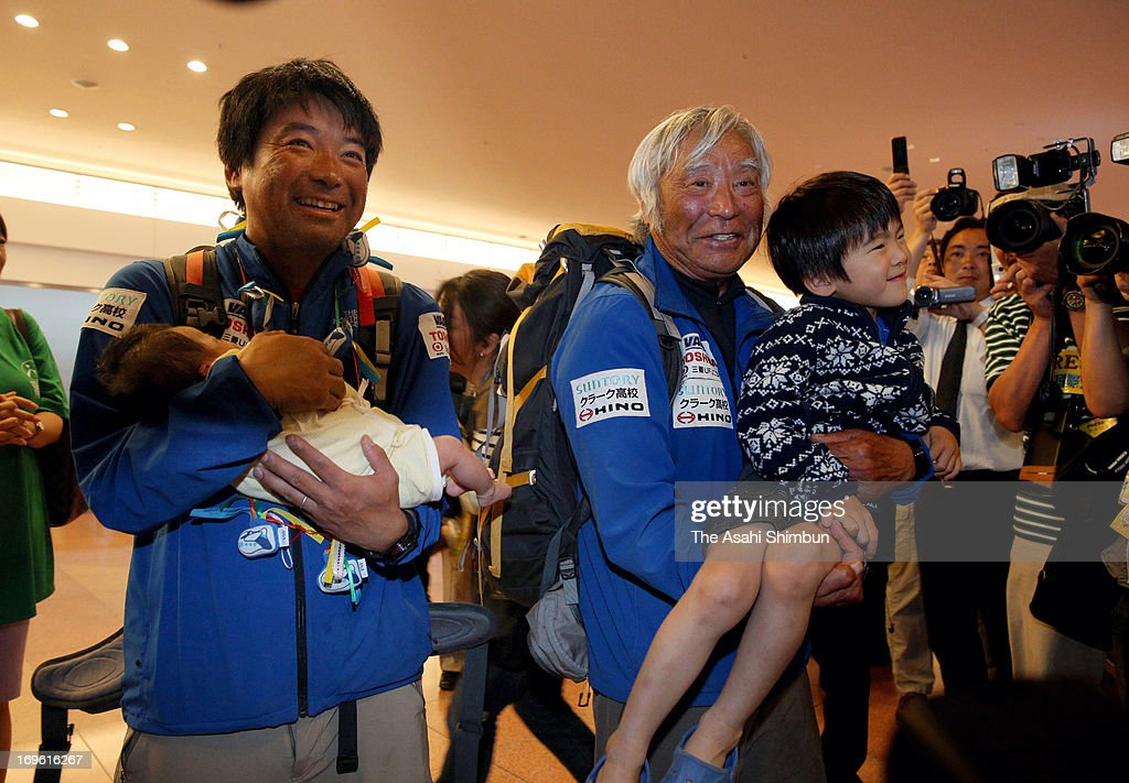 80-year-old adventurer Yuichiro Miura holding his grandson, is welcomed by his family members and media upon arrival at Tokyo International Airport on May 29, 2013 in Tokyo, Japan. Miura reached the summit of Mt. Everest at the age of 80, became the oldest man climbed the world's highest mountain.