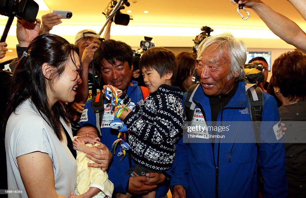 80-year-old adventurer Yuichiro Miura (R) is welcomed by his family members and media upon arrival at Tokyo International Airport on May 29, 2013 in Tokyo, Japan. Miura reached the summit of Mt. Everest at the age of 80, became the oldest man climbed the world's highest mountain.