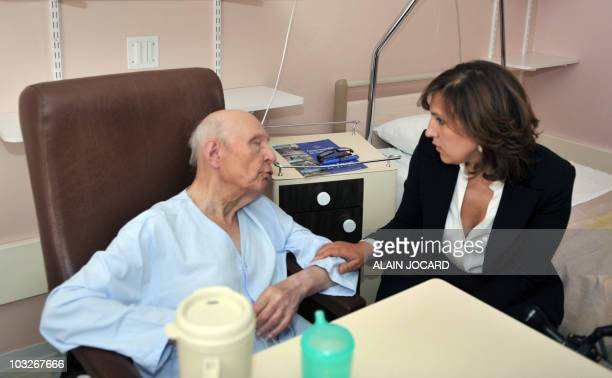 80yearold Frenchman Francois Deweille speaks to Nora Berra French junior minister in charge of Elders on August 2 2010 at the Chateaudun hospital...
