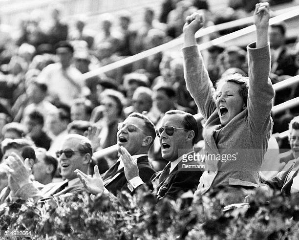 8/1/1952Helsinki Finland Princess Beatrix of the Netherlands leaps into the air with excitement during Wednesday's HollandHungary water polo game at...