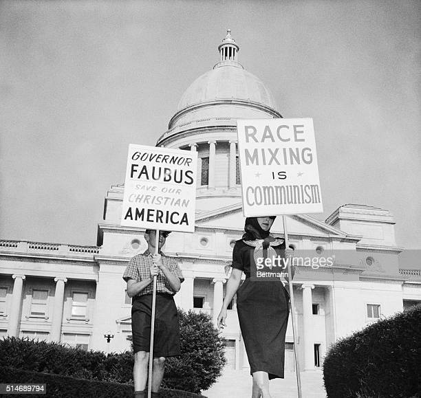 8/12/59Little Rock Arkansas A woman and a child both of whom refused to identify themselves March in front of the Arkansas Capitol here August 12th...