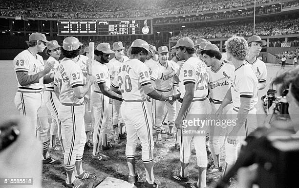8/14/1979St Louis MO As the scoreboard flashes 3 St Louis Cardinals' Lou Brock is surrounded by teammates after getting his 3000th career hit in the...