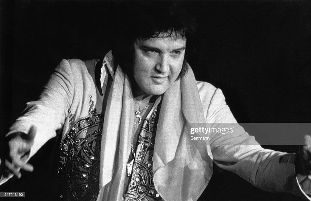 Elvis Presley, 42, died 8/16 in Memphis, TN, of repiratory failure at Baptist Hospital. Presley, the gyrating, hip-swinging King of Rock and Roll is shown during 6/20 concert here.