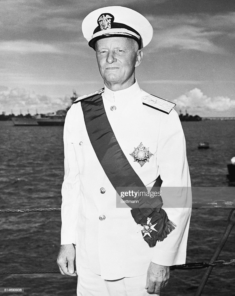 Fleet Admiral Chester W. Nimitz, commander-in-chief of the U.S. Pacific fleet, is shown on the deck of the HMS Duke of York, flagship of the British Pacific fleet, after he had been decorated with the order of the bath, Knight Grand Cross, by Admiral Sir Bruce Frazer, GCB, KBE, commander-in-chief of the British Pacific fleet.
