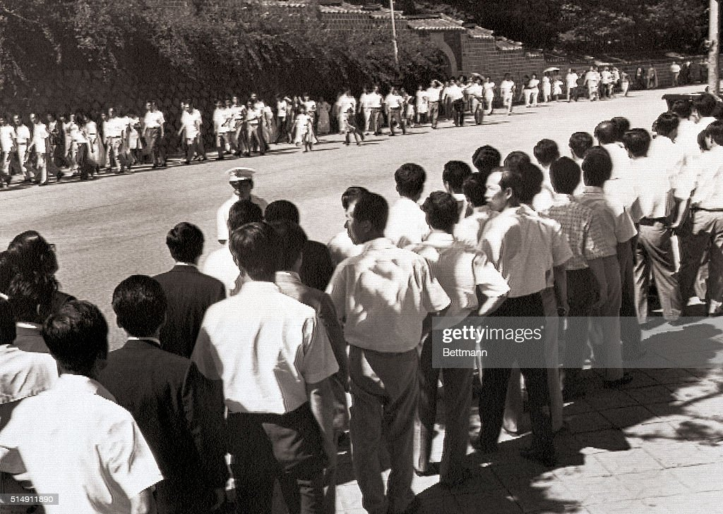 8/17Seoul Korea People form long lines along a road leading to the presidential mansion to pay their last tribute to the slain First Lady Mrs Park...