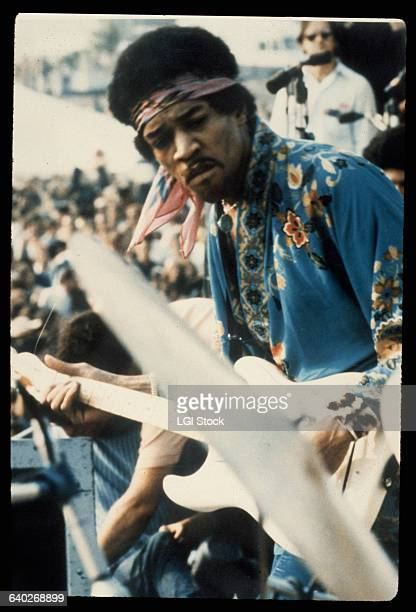 Closeup of Jimi Hendrix performing at the Woodstock Festival