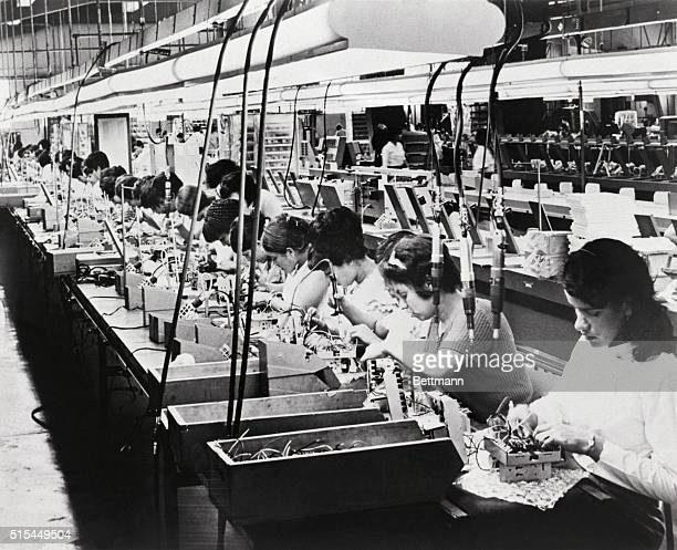 Hato Rey Puerto RicoORIGINAL CAPTION READS General view shows the assembly line of women where electronic timers are progressively wired and...