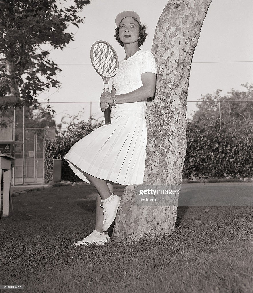 Helen Wills Moody Poses with Tennis Racquet