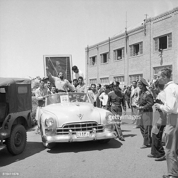 8/25/1953Tehran Iran A huge portrait of the Shah of Iran is carried through the streets of Tehran by followers of the 33yearold monarch as he makes...