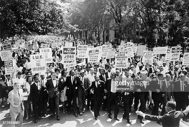 8/29/1963Washington DC Leaders of the March on Washington lock arms and put hands together as they move along Constitution Avenue here Aug 28 A...