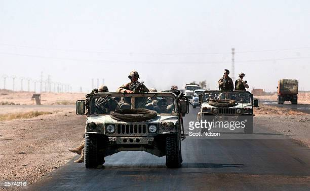 82nd Airborne Division 1st battalion 504th regiment humvees patrol in a convoy October 9 2003 along highway 10 near the Abu Ghraib prison west of...