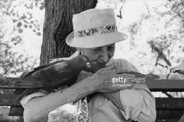 82yearold Phyllis Bodyn holds two pigeons from the flock she feeds daily on Riverside Drive Upper West Side New York City 1986 Phyllis has been...