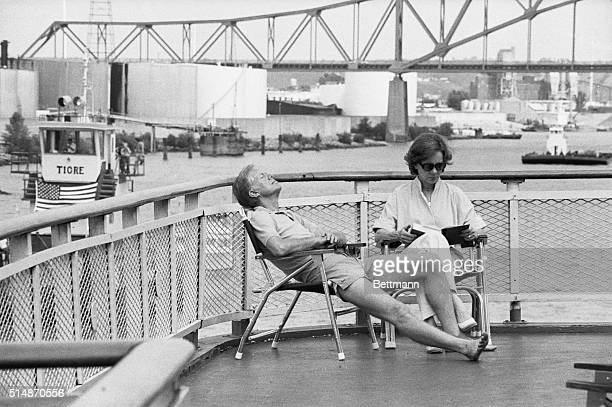 President Jimmy Carter and his wife Rosalynn relax in the sun aboard the riverboat The Delta Queen August 20 after the craft left Dubuque Shoeless...