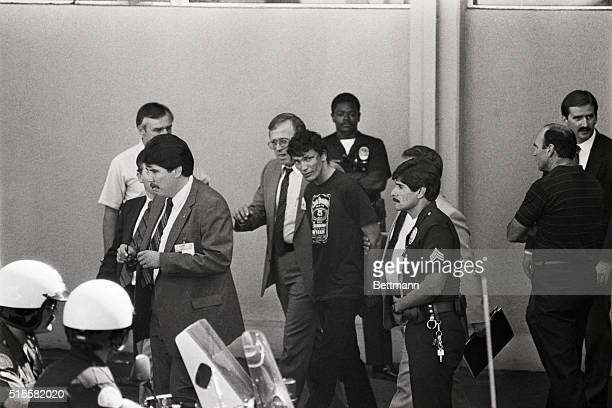 8/31/85Los Angeles California Richard Ramirez the man police have arrested as the alleged Night Stalker is surrounded by police officers as he walks...