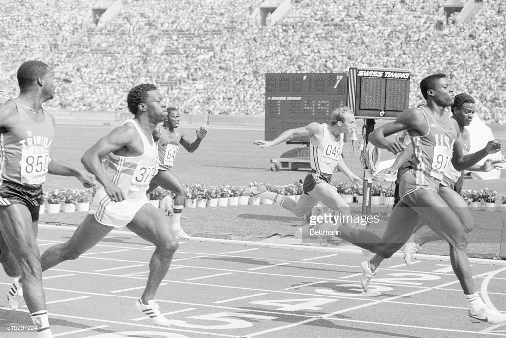 8/3/1984Los Angeles CA American athlete Carl Lewis coasts to victory in his 100m firstround heat in a time of 1032 seconds kicking off his bid for...