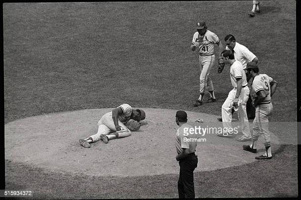 Clutching leg St louis Cardinal ace pitcher Bob Gibson in pain on mound 8/4 at start of fourth inning Gibson who had injured leg as a baserunner...