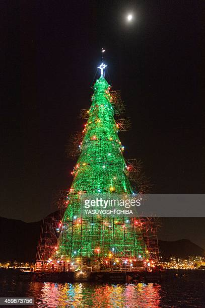 A 85meterhigh floating Christmas tree illuminates the Rodrigo de Freitas lagoon in Rio de Janeiro Brazil on December 2 2014 The world highest...