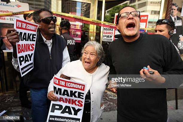 85yearold Julia Botello and two other protesters chant as they leave a Bank of America just before police begin arresting demonstrators for occupying...